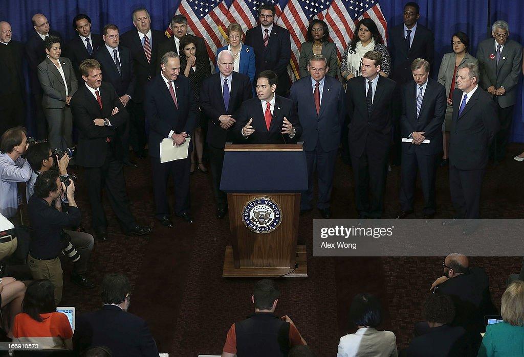 U.S. Sen. Marco Rubio (R-FL) (C) speaks as (L-R) Sen. Jeff Flake (R-AZ), Sen. Chuck Schumer (D-NY), Sen. John McCain (R-AZ), Sen. Bob Menendez (D-NJ), Sen. Michael Bennet (D-CO), Sen. Lindsey Graham (R-SC), and Sen. Richard Durbin (D-IL), also known as the Gang of Eight, listen during a news conference on immigration reform April 18, 2013 on Capitol Hill in Washington, DC. The senators discussed the Border Security, Economic Opportunity, and Immigration Modernization Act.