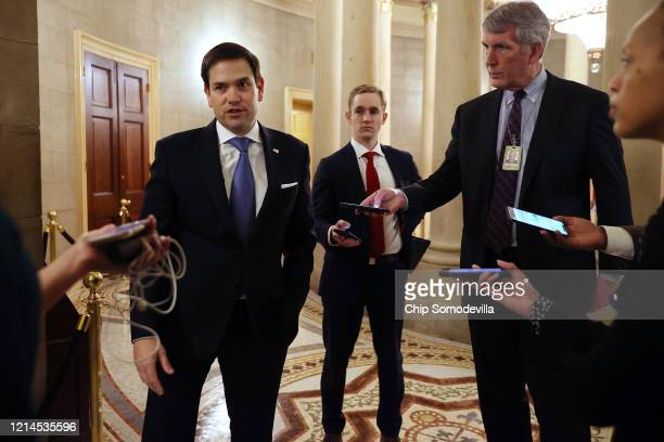 Sen Marco Rubio talks to reporters after leaving a meeting with fellow Republican senators and Treasury Secretary Steven Mnuchin as negotiations...
