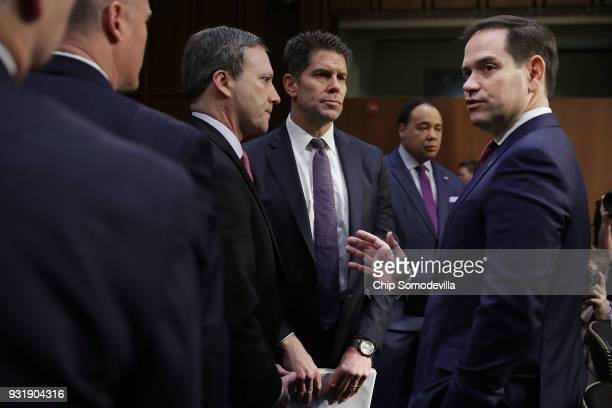 Sen Marco Rubio talks with Acting Deputy Director of the Federal Bureau of Investigation David Bowdich and other officials before a Senate Judiciary...