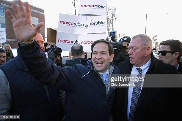 Sen Marco Rubio waves goodbye after stopping to thank supporters outside the polling place at Webster School February 9 2016 in Manchester New...