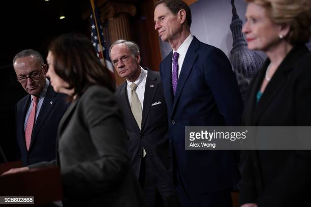 Sen. Maria Cantwell speaks as Senate Minority Leader Sen. Chuck Schumer , Sen. Tom Carper , Sen. Ron Wyden , and Sen. Debbie Stabenow listen during a...