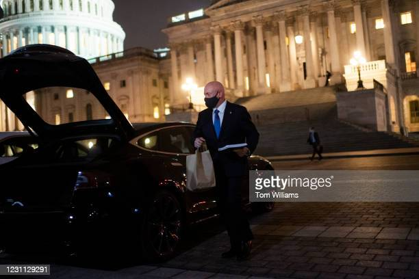 Sen. Mark Kelly, D-Ariz., walks to his Tesla on the East Front of the Capitol after the fourth day of former President Donald Trumps impeachment...
