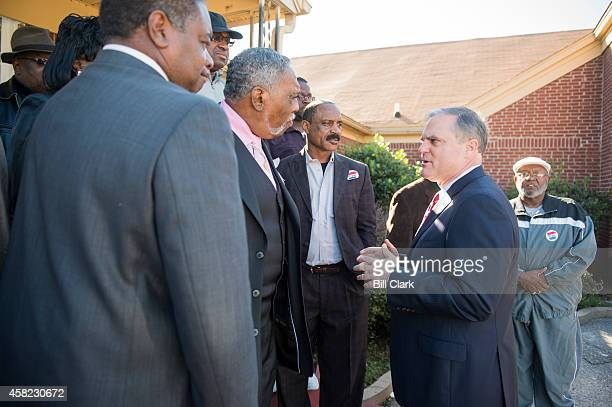 Sen Mark Pryor DArk right speaks with local religious leaders at the Beautiful Zion Church in West Memphis Ark on Saturday Nov 1 2014