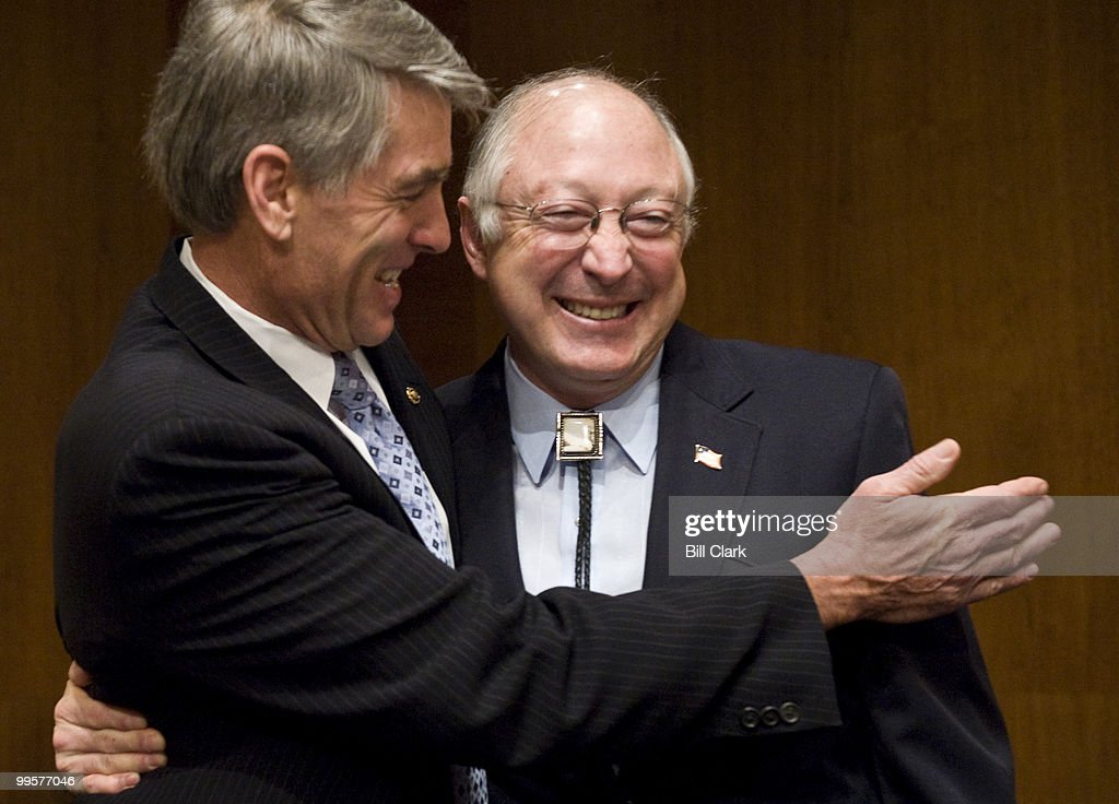 Sen. Mark Udall, D-Colo., left, welcomes Interior Secretary Ken Salazar to the Senate Energy and Natural Resources Committee for the hearing on energy development on public lands and the outer Continental Shelf on Tuesday, March 17, 2009.