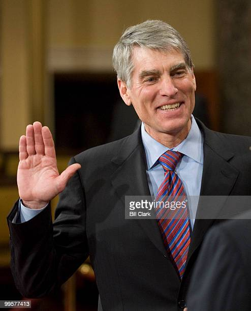 Sen. Mark Udall, D-Colo., poses for photos during his mock swearing in ceremony in the Old Senate Chamber on Tuesday, Jan. 6, 2009.