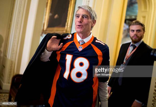 Sen. Mark Udall, D-Colo., sports a Denver Broncos Peyton Manning jersey in the Capitol en route to the senate luncheons on the day President Obama...