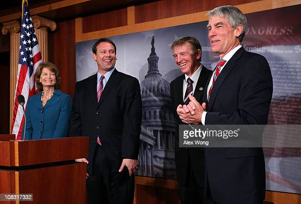 S Sen Mark Udall speaks as Sen Lisa Murkowski Rep Heath Shuler and Rep Paul Gosar listen during a news conference January 25 2011 on Capitol Hill in...