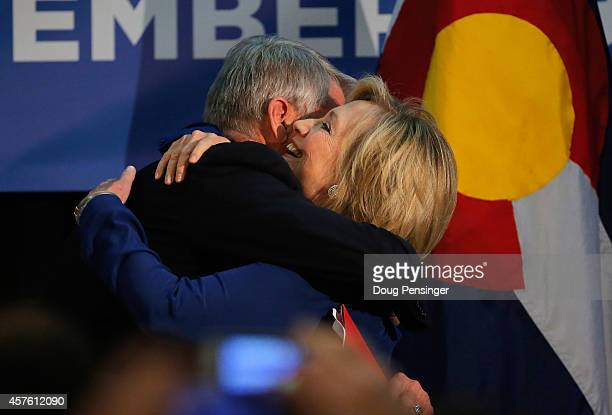 Sen. Mark Udall welcomes former Secretary of State Hillary Clinton to the stage at a rally on October 21, 2014 in Aurora, Colorado. Udall and Clinton...
