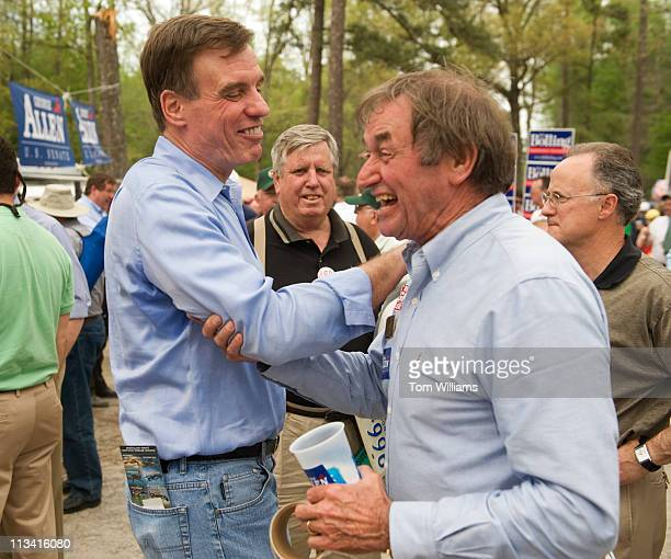 Sen. Mark Warner, D-Va., left, shares a laugh with Riley Ingram, a republican delegate from the 62nd district, during the 63rd Annual Shad Planking...