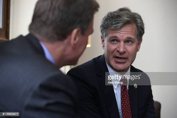 S Sen Mark Warner meets with FBI Director nominee Christopher Wray on Capitol Hill July 13 2017 in Washington DC If confirmed Wray will fill the...