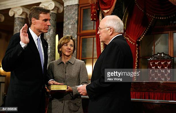S Sen Mark Warner poses for photographers with his wife Lisa Collis and Vice President Dick Cheney during a mock swearingin ceremony on Capitol Hill...