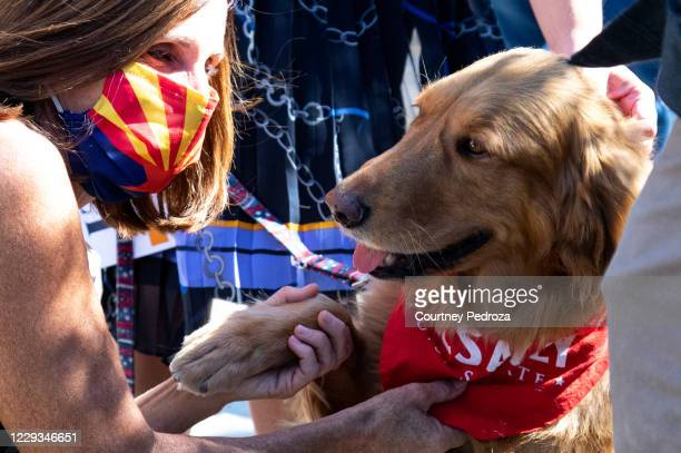 Sen. Martha McSally and her dog, Boomer, complete a trick during a campaign event on October 29, 2020 in Scottsdale, Arizona. McSally is running...