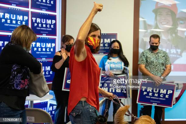 Sen. Martha McSally gives supporters a thumbs-up before leaving the phone bank on October 29, 2020 in Phoenix, Arizona. McSally is running against...