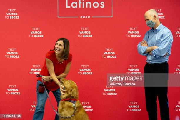 Sen. Martha McSally shows supporters one of Boomers tricks at a phone bank with Sen. Rick Scott on October 29, 2020 in Phoenix, Arizona. McSally is...
