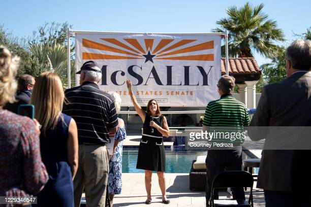Sen. Martha McSally sings God Bless America with supporters on October 29, 2020 in Scottsdale, Arizona. McSally is running against Democratic Senate...