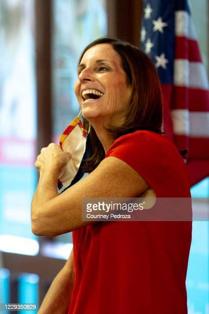 Sen. Martha McSally takes off her face covering before speaking to supporters at a phone bank with Sen. Rick Scott on October 29, 2020 in Phoenix,...