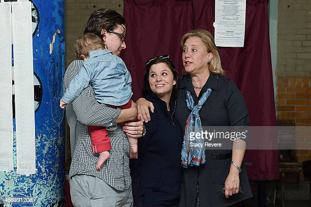 S Sen Mary Landrieu speaks with her son Connor Snellings and daughterinlaw Emily prior to voting on November 4 2014 in New Orleans Louisiana Landrieu...