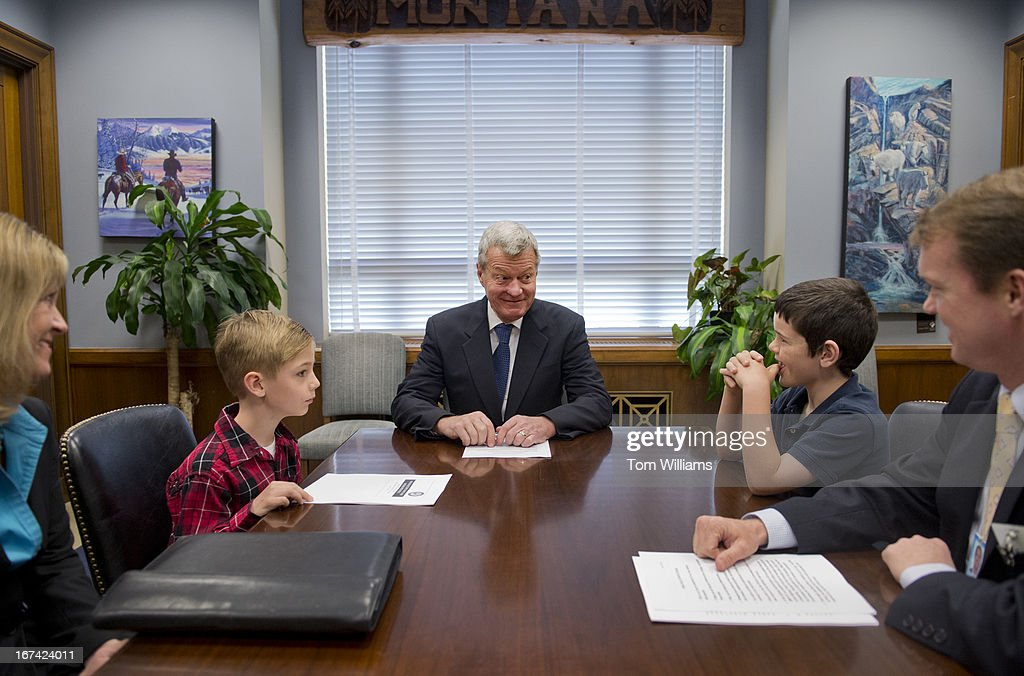 Sen. Max Baucus, D-Mont., talks with Zach Bensky, 7, left, son of staff director Amber Cottle, far left, and Colin Neary, 7, son of communications director Sean Neary, not pictured, prior to a Senate Finance Committee staff meeting in Dirksen on 'Take Our Daughters and Sons to Work Day.' Mac Campbell, chief counsel, appears at right.