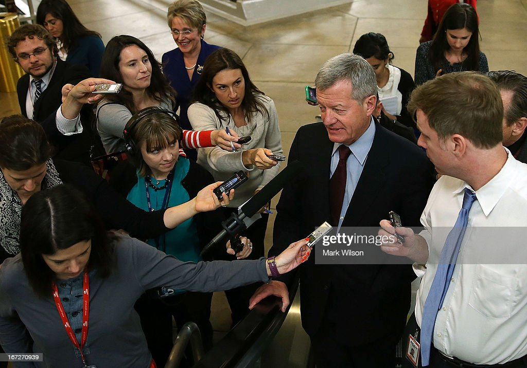 Sen. Max Baucus (D-MT) is trailed by reporters April 23, 2013 on Capitol Hill in Washington, DC. It was announced earlier that Baucus, after 36 years in the Senate, will not seek reelection in 2014.