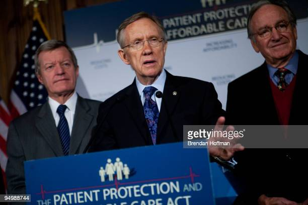 Sen Max Baucus Senate Majority Leader Harry Reid and Sen Tom Harkin speak at a news conference on health insurance reform legislation on December 21...
