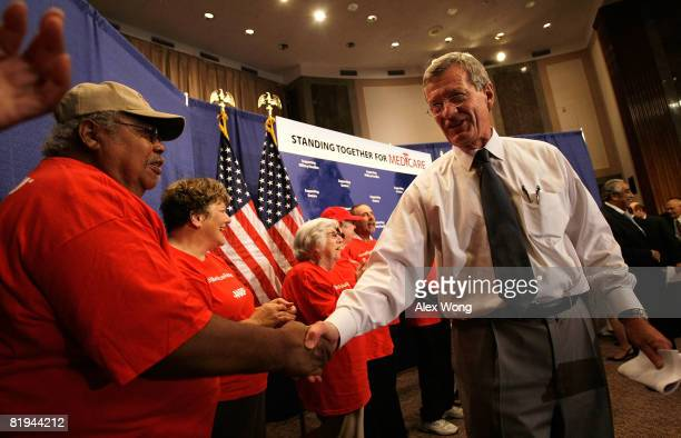 S Sen Max Baucus shakes hands with members of AARP during a rally to support the enactment of the Medicare bill July 15 2008 on Capitol Hill in...