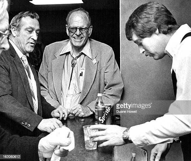 JAN 15 1981 JAN 16 1982 Sen Maynard Yost RCrook left has a drink with Dave Rice chief lobbyist for Colorado Cattlemen's Association at Friday luncheon