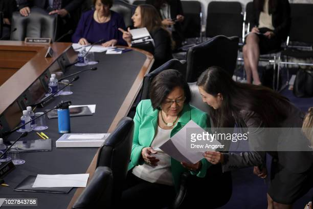 Sen Mazie Hirono confers with an aide as Supreme Court nominee Judge Brett Kavanaugh testifies before the Senate Judiciary Committee on the third day...