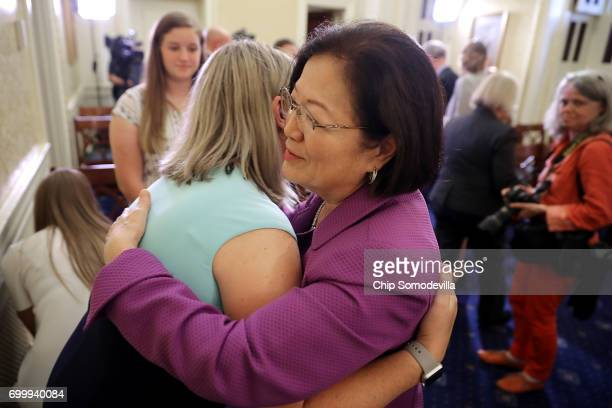S Sen Mazie Hirono embraces Jill Hile of Hilliard Ohio whose daughter Allison lives with cystic fibrosis following a news conference after the...