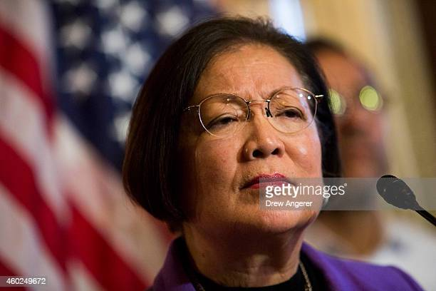 Sen Mazie Hirono listens to a question during a news conference to discuss US President Barack Obama's executive order on immigration on Capitol Hill...