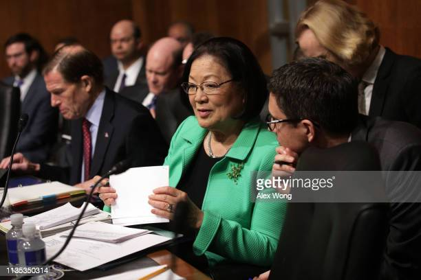 S Sen Mazie Hirono listens to an aide during a hearing before the Senate Judiciary Committee March 12 2019 on Capitol Hill in Washington DC The...