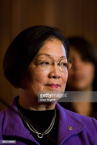 Sen Mazie Hirono looks on during a news conference to discuss US President Barack Obama's executive order on immigration on Capitol Hill December 10...