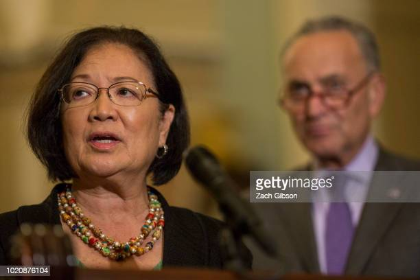 Sen Mazie Hirono speaks during a weekly news conference on Capitol Hill on August 21 2018 in Washington DC Pictured at right is Senate Minority...