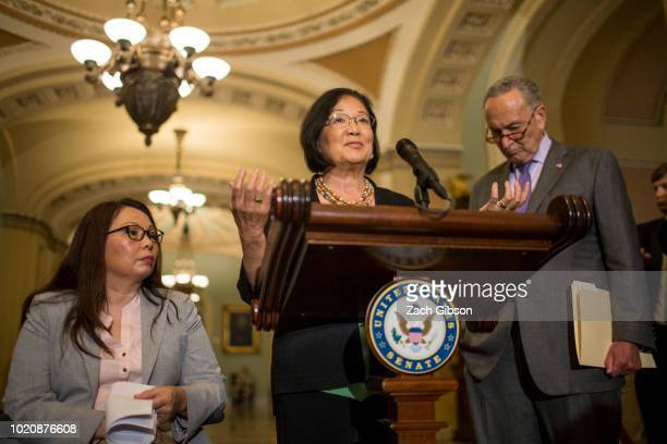 Sen Mazie Hirono speaks during a weekly news conference on Capitol Hill on August 21 2018 in Washington DC Also pictured are Sen Tammy Duckworth and...