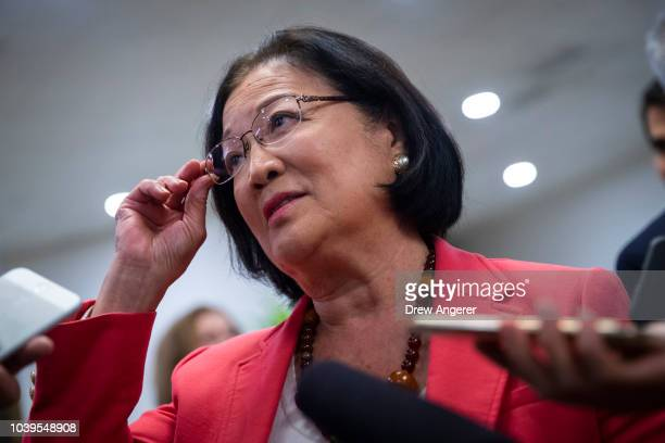 Sen Mazie Hirono speaks to reporters on her way to a vote on Capitol Hill September 24 2018 in Washington DC Christine Blasey Ford who has accused...