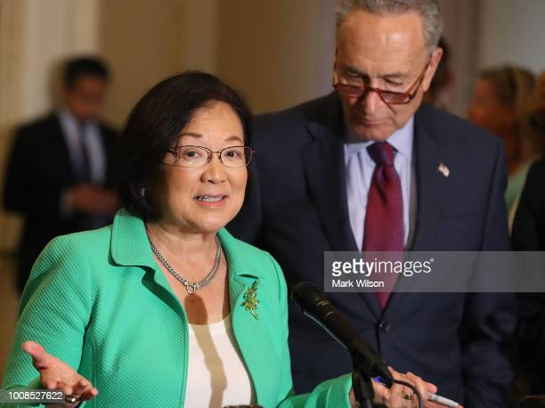 Sen Mazie Hirono speaks to the media while flanked by Senate Minority Leader Charles Schumer after attending the Senate Democrats policy luncheon on...