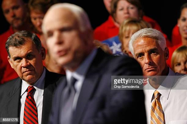 Sen Mel Martinez and Florida Governor Charlie Crist listen to Republican presidential nominee Sen John McCain during a rally at Maxwell C King Center...