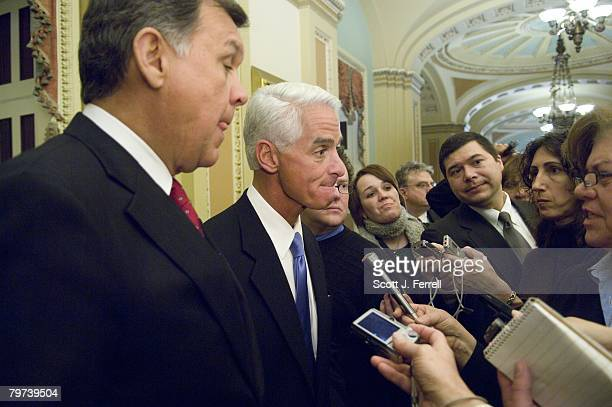 Sen Mel Martinez RFla and Florida Gov Charlie Crist talk to reporters after the Senate Republican policy luncheon at the US Capitol GOP presidential...
