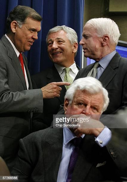 Sen. Mel Martinez , Sen. Chuck Hagel , Sen. John McCain and Sen. Ted Kennedy visit after a news conference at the Capitol April 6, 2006 in...