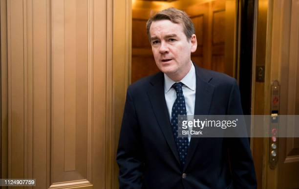 Sen Michael Bennet DColo arrives for the votes in the Senate to keep the government open on Feb 14 2019