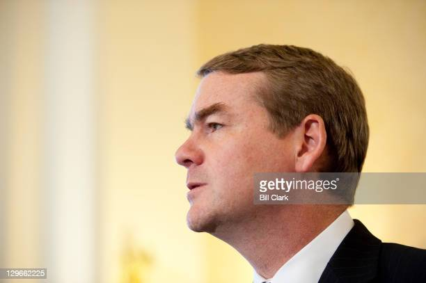 Sen Michael Bennet DColo holds a news conference with Sen Johnny Isakson RGa not pictured to introduce a bill that would enable better mortgage...