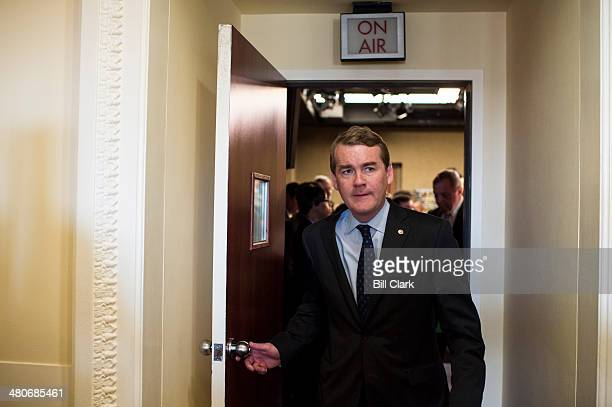 Sen Michael Bennet DColo leaves the Senate studio following the Senate Democrats' news conference to unveil A Fair Shot for Everyone agenda on...