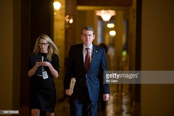 Sen Michael Bennet DColo walks to the Senate chamber on Wednesday May 15 2013