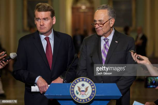 Sen Michael Bennet left and Senate Minority Leader Chuck Schumer are pictured during a weekly press conference following a policy luncheon on Capitol...