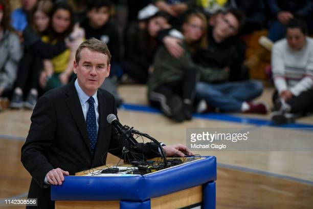 Sen Michael Bennet speaks during a candlelight vigil at Highlands Ranch High School on May 8 2019 in Highlands Ranch Colorado One student was killed...