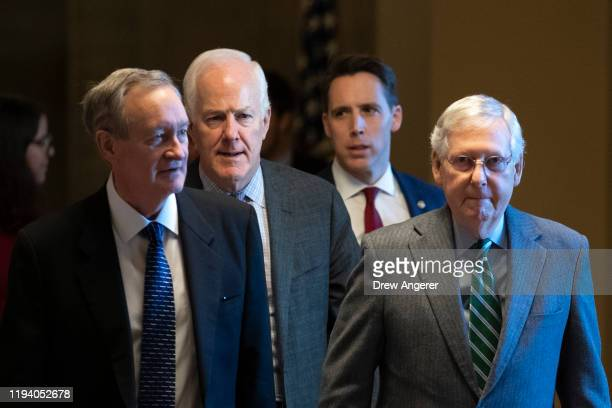 Sen. Mike Crapo , Sen. John Cornyn , Sen. Josh Hawley and Senate Majority Leader Mitch McConnell leave McConnell's office and walk to the Senate...