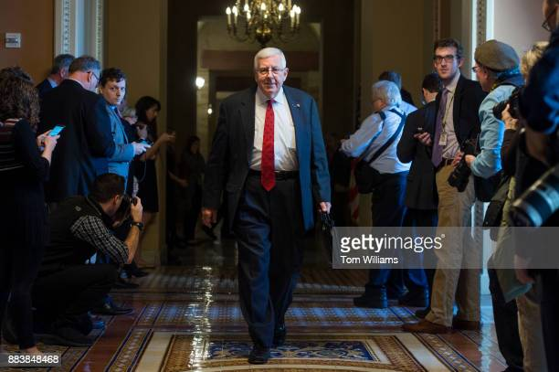 Sen Mike Enzi RWyo walks through the Capitol before Senate Majority Leader Mitch McConnell RKy announced that Republicans have enough votes to pass...