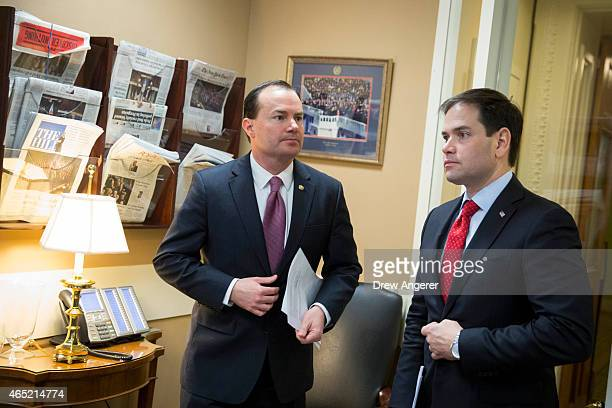 Sen Mike Lee and Sen Marco Rubio talk before a news conference to introduce their proposal for an overhaul of the tax code March 4 2015 on Capitol...