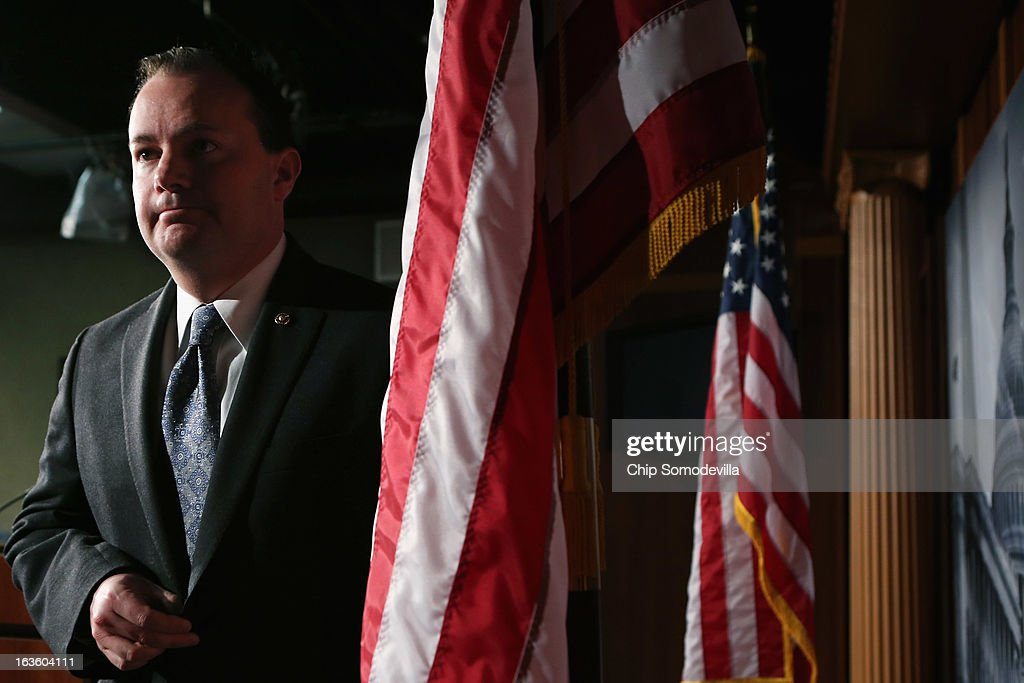 Sen. Mike Lee (R-UT) leaves after holding a news conference to announce their plan to defund the Patient Protection and Affordable Care Act, also known as Obamacare, at the U.S. Capitol March 13, 2013 in Washington, DC. Although Lee and his fellow sponsors expect the legislation to fail, they believe it is an important survey of who supports health care reform.
