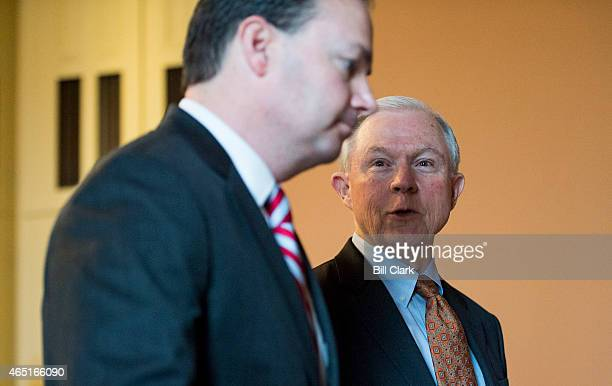 Sen Mike Lee RUtah left and Sen Jeff Sessions RAla talk as they walk to the Senate floor to lead the procession of Senators to the House floor for...