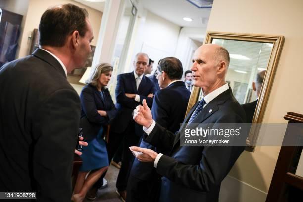 Sen. Mike Lee , Sen. Joni Ernst , Sen. Thom Tillis , Sen. John Barrasso Sen. Rick Scott mingle before attending a news conference on the debt ceiling...